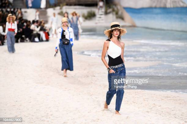 Models walk the runway during the Chanel show as part of the Paris Fashion Week Womenswear Spring/Summer 2019 on October 2 2018 in Paris France