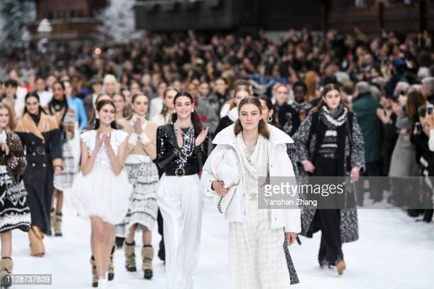 Models walk the runway during the Chanel show as part of the Paris Fashion Week Womenswear Fall/Winter 2019/2020 on March 5, 2019 in Paris, France.
