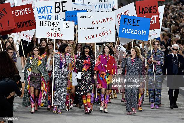 Models walk the runway during the Chanel show as part of the Paris Fashion Week Womenswear Spring/Summer 2015 on September 30 2014 in Paris France