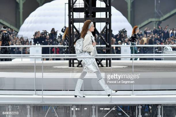 Models walk the runway during the Chanel show as part of the Paris Fashion Week Womenswear Fall/Winter 2017/2018 on March 7 2017 in Paris France