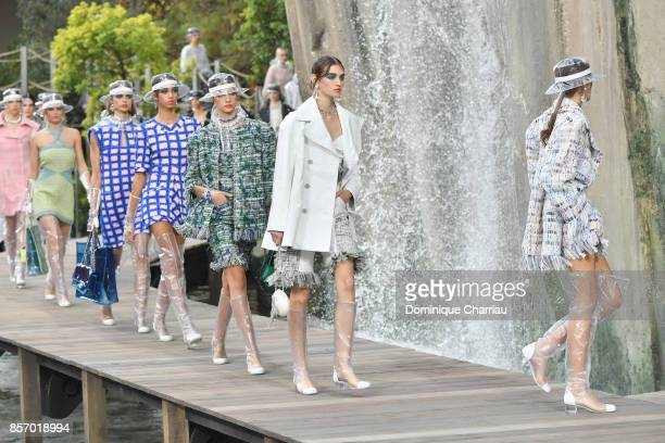 Models walk the runway during the Chanel show as part of the Paris Fashion Week Womenswear Spring/Summer 2018 on October 3 2017 in Paris France