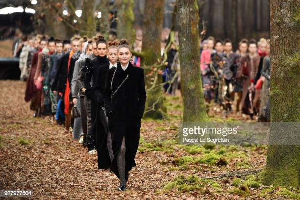 Models walk the runway during the Chanel show as part of the Paris Fashion Week Womenswear Fall/Winter 2018/2019 on March 6 2018 in Paris France