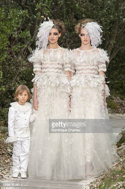 Models walk the runway during the Chanel Spring/Summer 2013 Haute-Couture show as part of Paris Fashion Week at Grand Palais on January 22, 2013 in...
