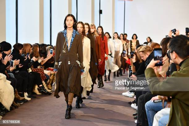 Models walk the runway during the Chloe show as part of the Paris Fashion Week Womenswear Fall/Winter 2018/2019 on March 1 2018 in Paris France