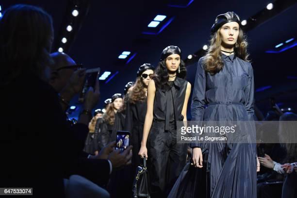 Models walk the runway during the Christian Dior show as part of the Paris Fashion Week Womenswear Fall/Winter 2017/2018 at Musee Rodin on March 3...