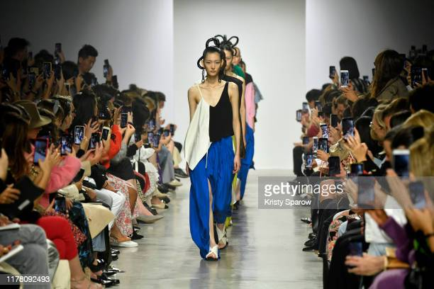 Models walk the runway during the Christian Wijnants Womenswear Spring/Summer 2020 show as part of Paris Fashion Week on September 27, 2019 in Paris,...