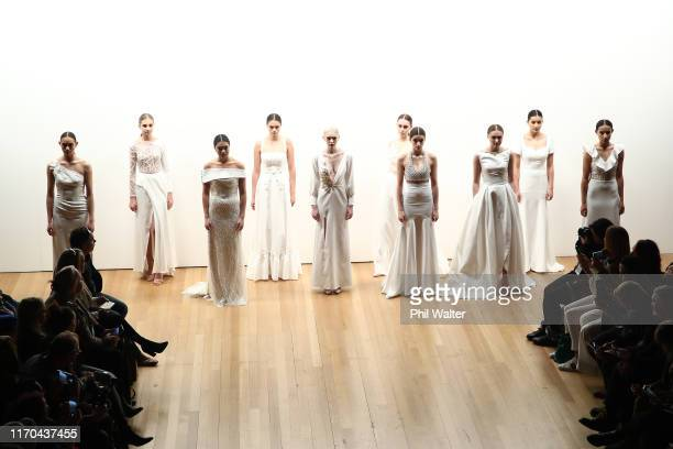 Models walk the runway during the Collections: Ivory and Stone Bridal show during New Zealand Fashion Week 2019 at Auckland Town Hall on August 27,...