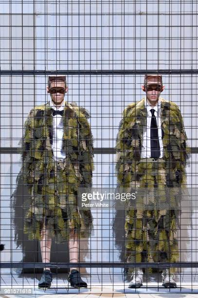 Models walk the runway during the Comme des Garcons Menswear Spring/Summer 2019 show as part of Paris Fashion Week on June 22 2018 in Paris France