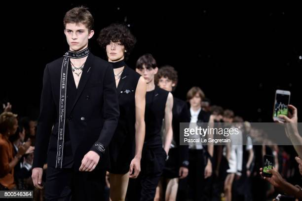 Models walk the runway during the Dior Homme Menswear Spring/Summer 2018 show as part of Paris Fashion Week on June 24 2017 in Paris France