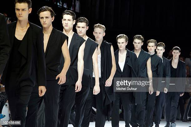 Models walk the runway during the Dior Homme show as part of Paris Menswear Fashion Week Spring/Summer 2011 at Halle Freyssinet on June 26, 2010 in...