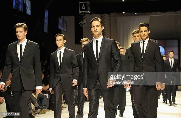 Models walk the runway during the Dolce Gabbana Milan Menswear Spring/Summer 2011 show on June 19 2010 in Milan Italy