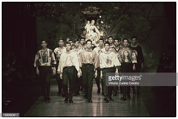 Models walk the runway during the Dolce Gabbana show as part of Milan Fashion Week Menswear Autumn/Winter 2013 on January 12 2013 in Milan Italy
