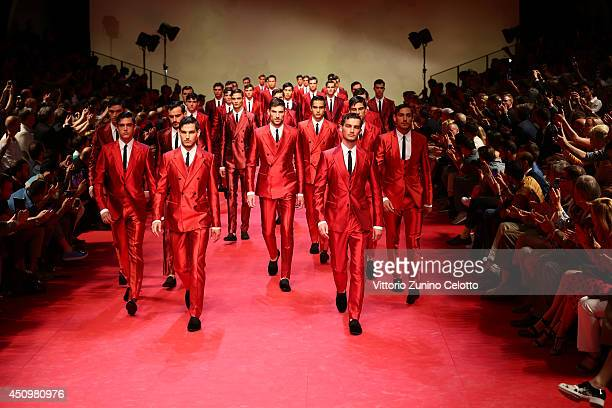 Models walk the runway during the Dolce Gabbana show as part of Milan Fashion Week Menswear Spring/Summer 2015 on June 21 2014 in Milan Italy