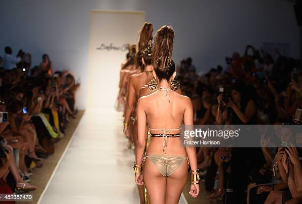 Models walk the runway during the Dolores Cortes show with TRESemme at MercedesBenz Fashion Week Swim 2015 at Cabana Grande at The Raleigh on July 18...