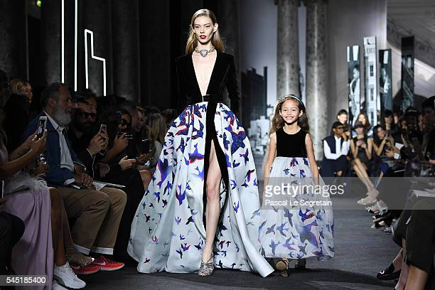 Models walk the runway during the Elie Saab Haute Couture Fall/Winter 20162017 show as part of Paris Fashion Week on July 6 2016 in Paris France