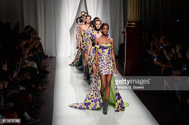 Models walk the runway during the Emanuel Ungaro show as part of the Paris Fashion Week Womenswear Spring/Summer 2017 on September 30, 2016 in Paris,...