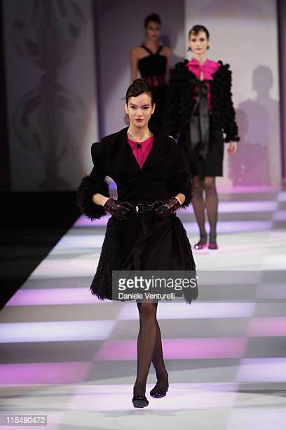 Models walk the runway during the Emporio Armani fashion show as part of Milan Fashion Week Autumn/Winter 2008/09 on February 17, 2008 in Milan,...