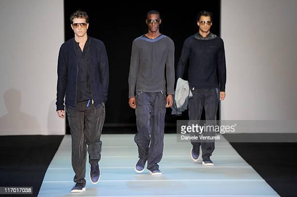 Models walk the runway during the Emporio Armani fashion show as part of Milan Fashion Week Menswear Spring/Summer 2012 on June 19, 2011 in Milan,...