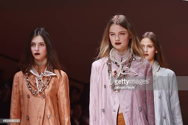 Models walk the runway during the Emporio Armani fashion show as part of Milan Fashion Week Spring/Summer 2016 on September 25 2015 in Milan Italy