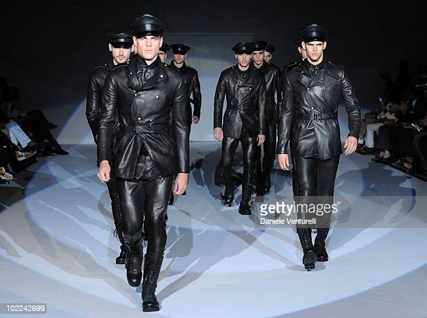 Models walk the runway during the Emporio Armani Milan Menswear Spring/Summer 2011 show on June 20 2010 in Milan Italy
