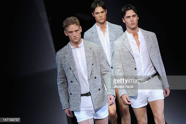 Models walk the runway during the Emporio Armani show as part of Milan Fashion Week Menswear Spring/Summer 2013 on June 25, 2012 in Milan, Italy.