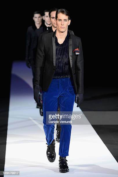 Models walk the runway during the Emporio Armani show as part of Milan Fashion Week Menswear Autumn/Winter 2013 on January 14, 2013 in Milan, Italy.