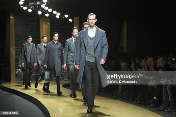 Models walk the runway during the Ermenegildo Zegna show as part of Milan Fashion Week Menswear Autumn/Winter 2013 on January 12, 2013 in Milan,...