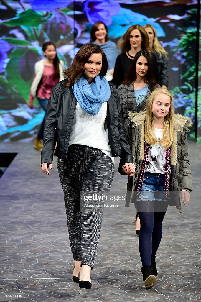 Models walk the runway during the Ernsting's family Fashion Show Autumn/Winter 2015 at Hotel Atlantic on July 16, 2015 in Hamburg, Germany.