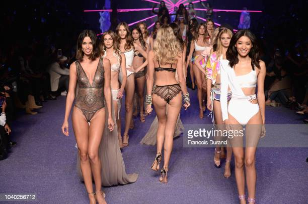 Models walk the runway during the ETAM show as part of the Paris Fashion Week Womenswear Spring/Summer 2019 on September 25 2018 in Paris France