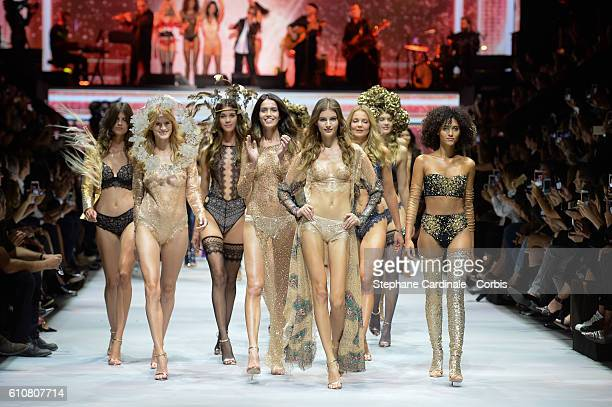 Models walk the runway during the Etam show as part of the Paris Fashion Week Womenswear Spring/Summer 2017 on September 27 2016 in Paris France