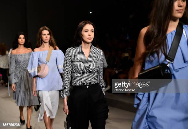 Models walk the runway during the Eudon Choi show at Fashion Forward October 2017 held at the Dubai Design District on October 26 2017 in Dubai...