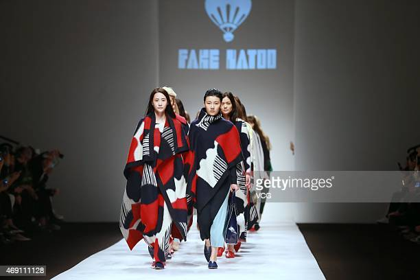 Models walk the runway during the FAKE NATOO show as part of Shanghai Fashion Week Autumn/Winter Collection on April 9, 2015 in Shanghai, China.