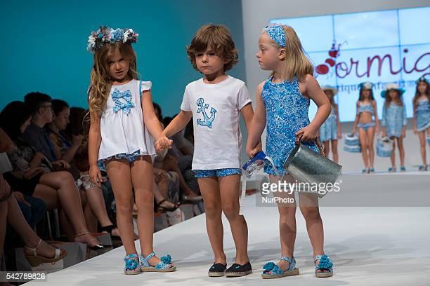 Models walk the runway during the FIMI at Pabellon de Cristal de la Casa de Campo on June 24 2016 in Madrid Spain