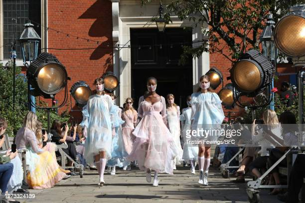 Models walk the runway during the finale at the Bora Aksu show during LFW September 2020 at St Paul's Church on September 18, 2020 in London, England.