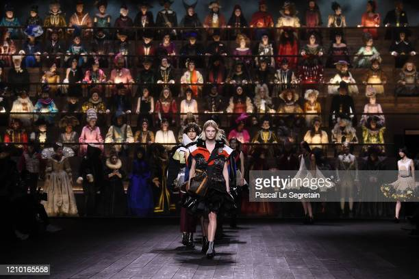 Models walk the runway during the finale at the Louis Vuitton show as part of the Paris Fashion Week Womenswear Fall/Winter 2020/2021 on March 03,...