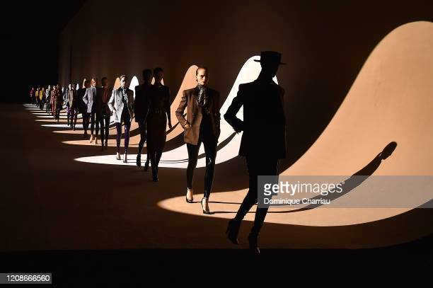 Models walk the runway during the finale at the Saint Laurent show as part of the Paris Fashion Week Womenswear Fall/Winter 2020/2021 on February 25,...