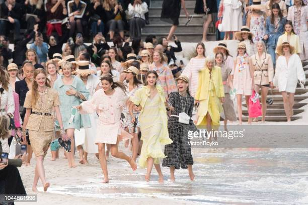 Models walk the runway during the finale of the Chanel show as part of the Paris Fashion Week Womenswear Spring/Summer 2019 on October 2 2018 in...