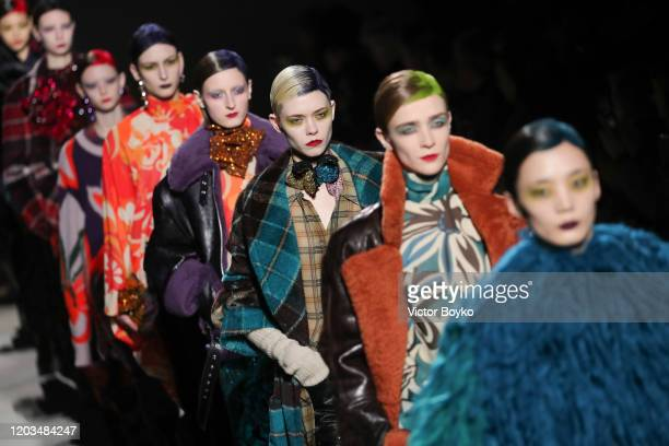 Models walk the runway during the finale of the Dries Van Noten show as part of the Paris Fashion Week Womenswear Fall/Winter 2020/2021 on February...