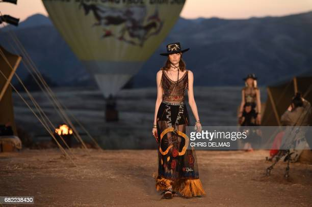 Models walk the runway during the first cruise collection by Maria Grazia Chiuri for Dior show in the Upper Las Virgenes Canyon Calabasas California...