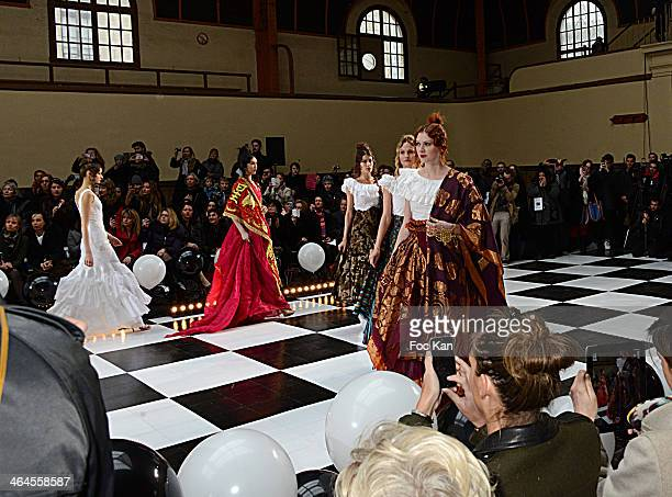 Models walk the runway during the Franck Sorbier show as part of Paris Fashion Week Haute Couture Spring/Summer at the Caserne De La Garde...