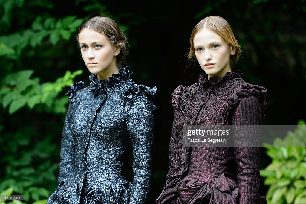 Models walk the runway during the Frank Sorbier show as part of Paris Fashion Week Haute-Couture Fall/Winter 2013-2014 at Hotel De Bezenval on July 3, 2013 in Paris, France.