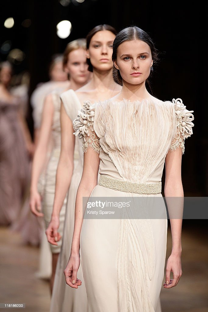 Models walk the runway during the Georges Hobeika Haute Couture Fall/Winter 2011/2012 show as part of Paris Fashion Week at Hotel Westin on July 4, 2011 in Paris, France.