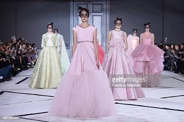 Models walk the runway during the Giambattista Vallishow as part of Paris Fashion Week Haute Couture Spring/Summer 2015 on January 26 2015 in Paris...