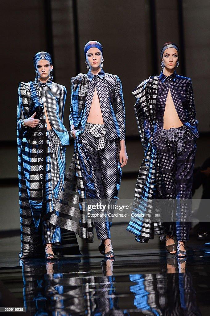 Models walk the runway during the Giorgio Armani Prive show as part of Paris Fashion Week Haute Couture Spring/Summer 2014, at Palais de tokyo in Paris.