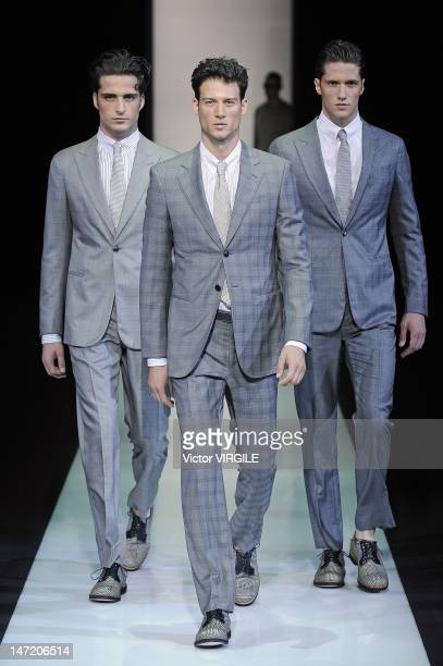 Models walk the runway during the Giorgio Armani show as part of Milan Fashion Week Menswear Spring/Summer 2013 on June 26 2012 in Milan Italy
