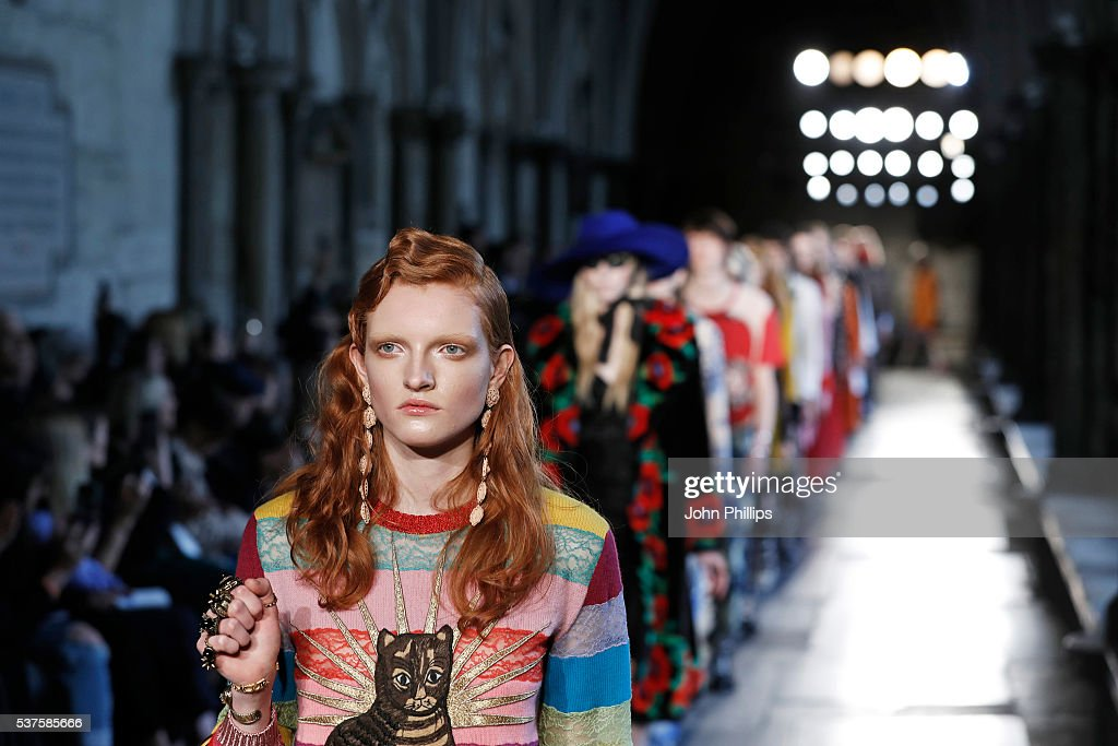 b86a68ca9b5d5b Models walk the runway during the Gucci Cruise 2017 fashion show at ...