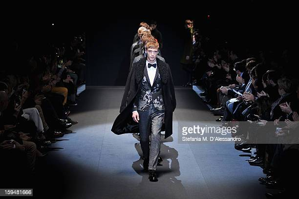 Models walk the runway during the Gucci show as part of Milan Fashion Week Menswear Autumn/Winter 2013 on January 14 2013 in Milan Italy