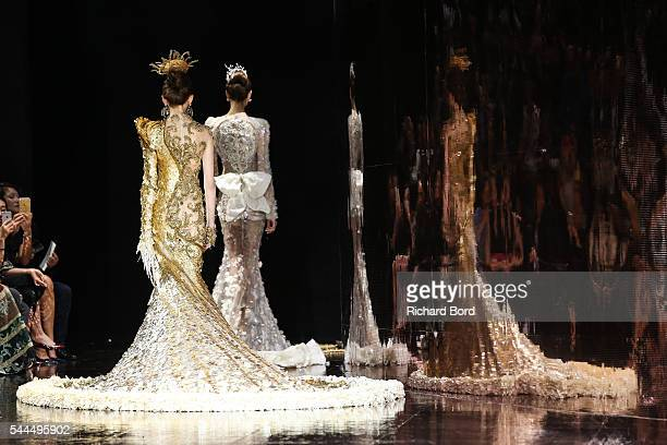Models walk the runway during the Guo Pei Haute Couture Fall/Winter 20162017 show as part of Paris Fashion Week on July 3 2016 in Paris France