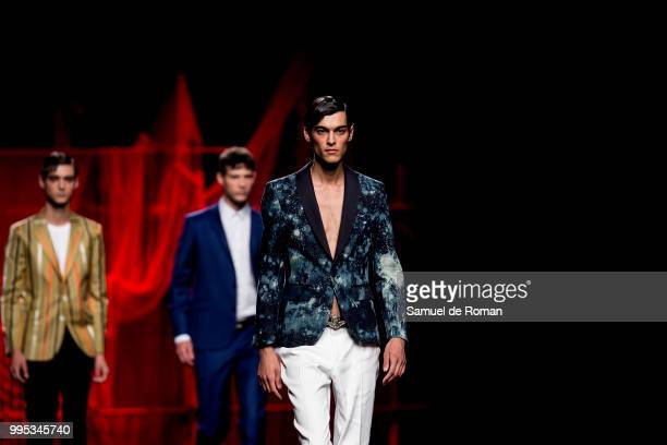 A models walk the runway during the Hannibal Laguna show at Mercedes Benz Fashion Week Madrid Spring/Summer 2019 on July 10 2018 in Madrid Spain