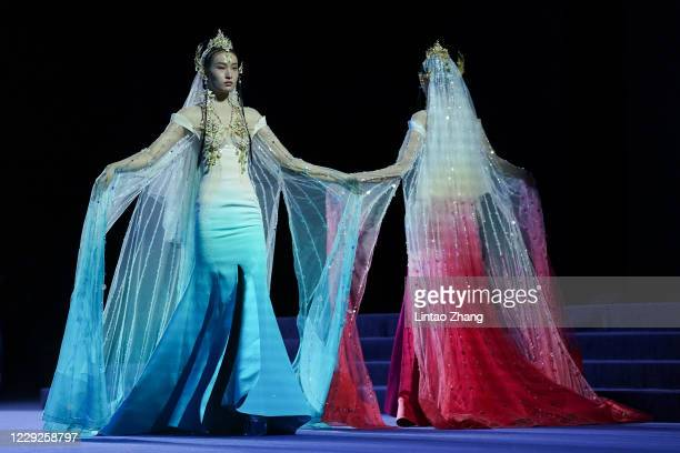 Models walk the runway during the Heaven Gaia collection show by Chinese designer Xiong Ying on day one of China Fashion Week at 751D.PARK on October...
